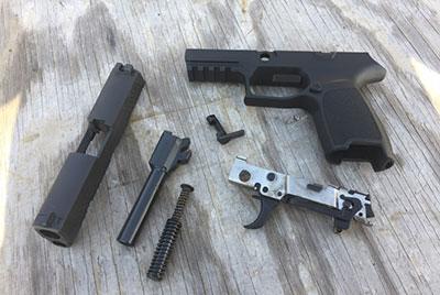 A disassembled sig p320