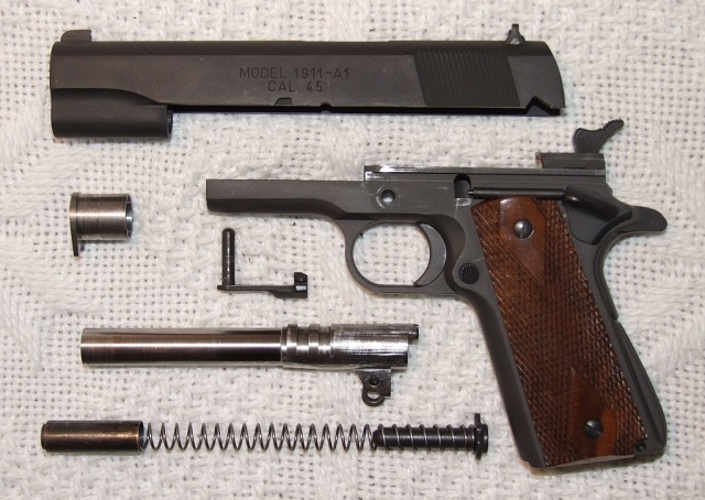 springfield 1911 handgun partially field stripped