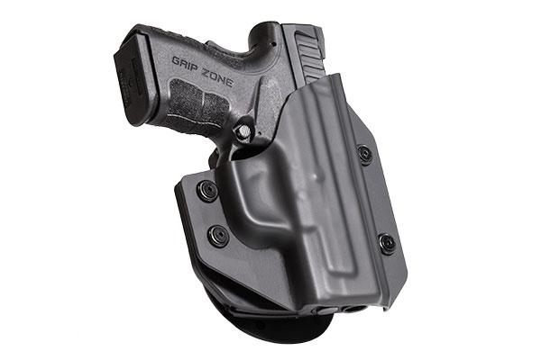 Glock 38 with Crimson Trace Defender Laser DS-121 OWB Paddle Holster