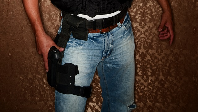 man wearing a thigh holster unconcealed